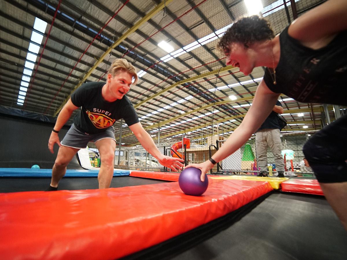 Adults playing dodgeball