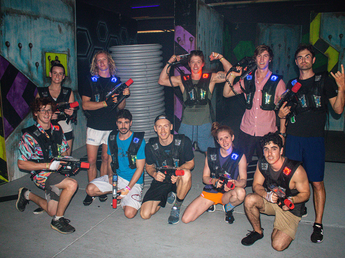 Group of adults playing laser tag
